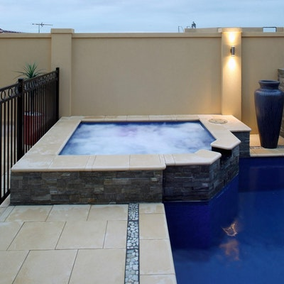 Ice Coral Pavers & Riverstone Border Pool Paving