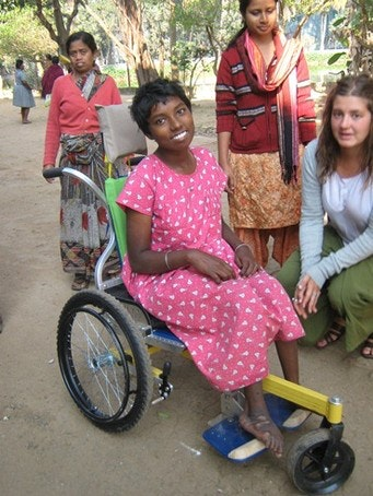Occupational Therapist, Tarin Dempers with Animika in her new wheelchair.