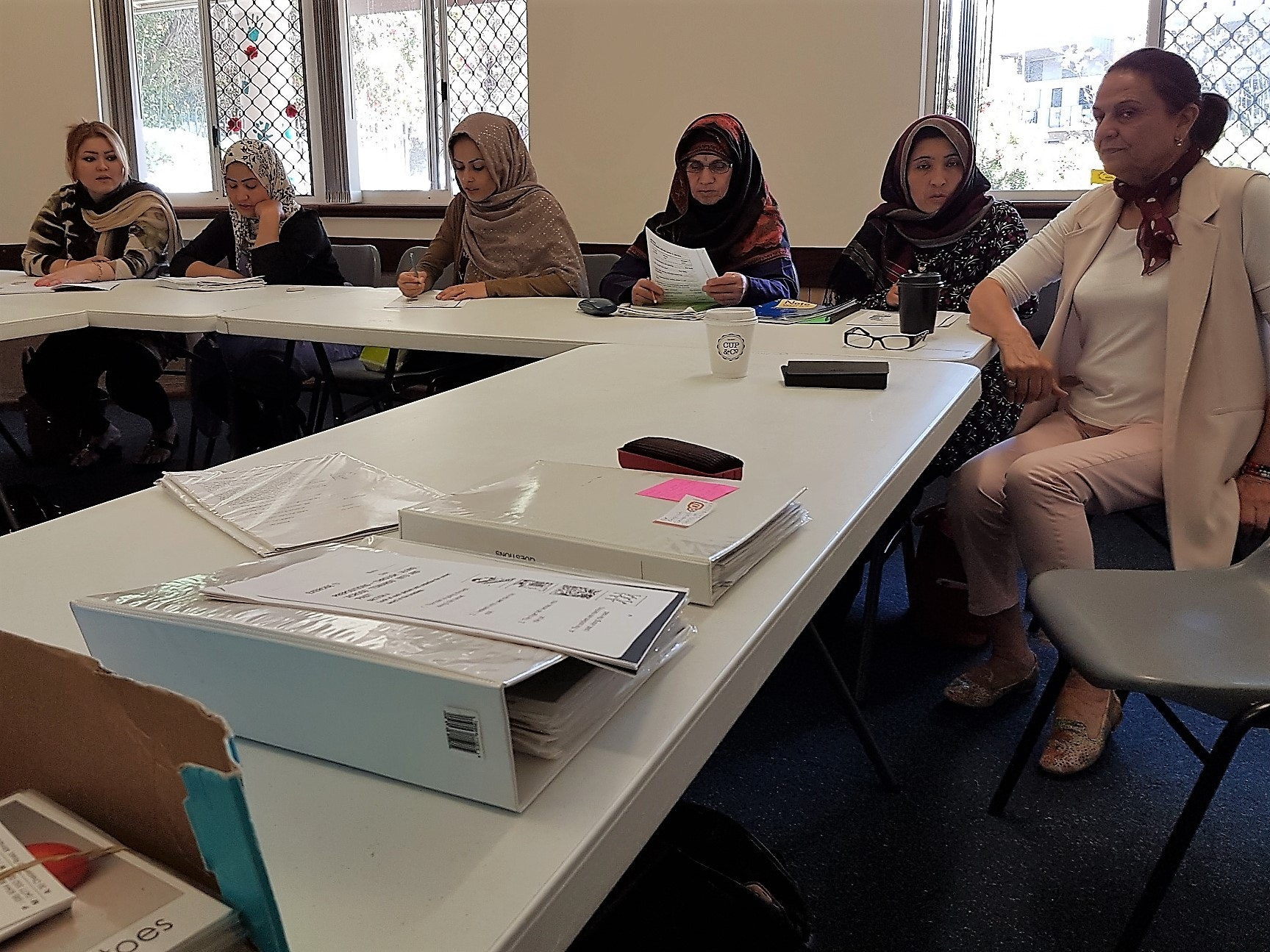 Group of Afghanistan Women attending the English Conversation Classes at Sudbury House. Their teacher on the right is Hadia Masud who speaks five languages.