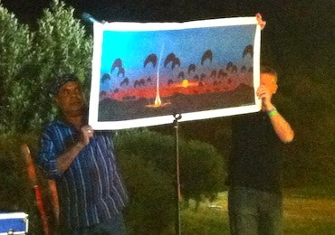 Tommy Crow donating his painting to Black Dog Ride