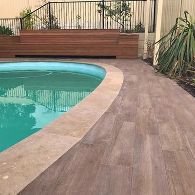 Jarrah StoneDek Pavers and Cappuccino Travertine Capping