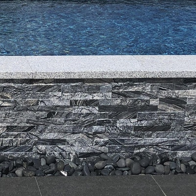 Empire Granite Capping and Hawaiian Swirl Wall Cladding