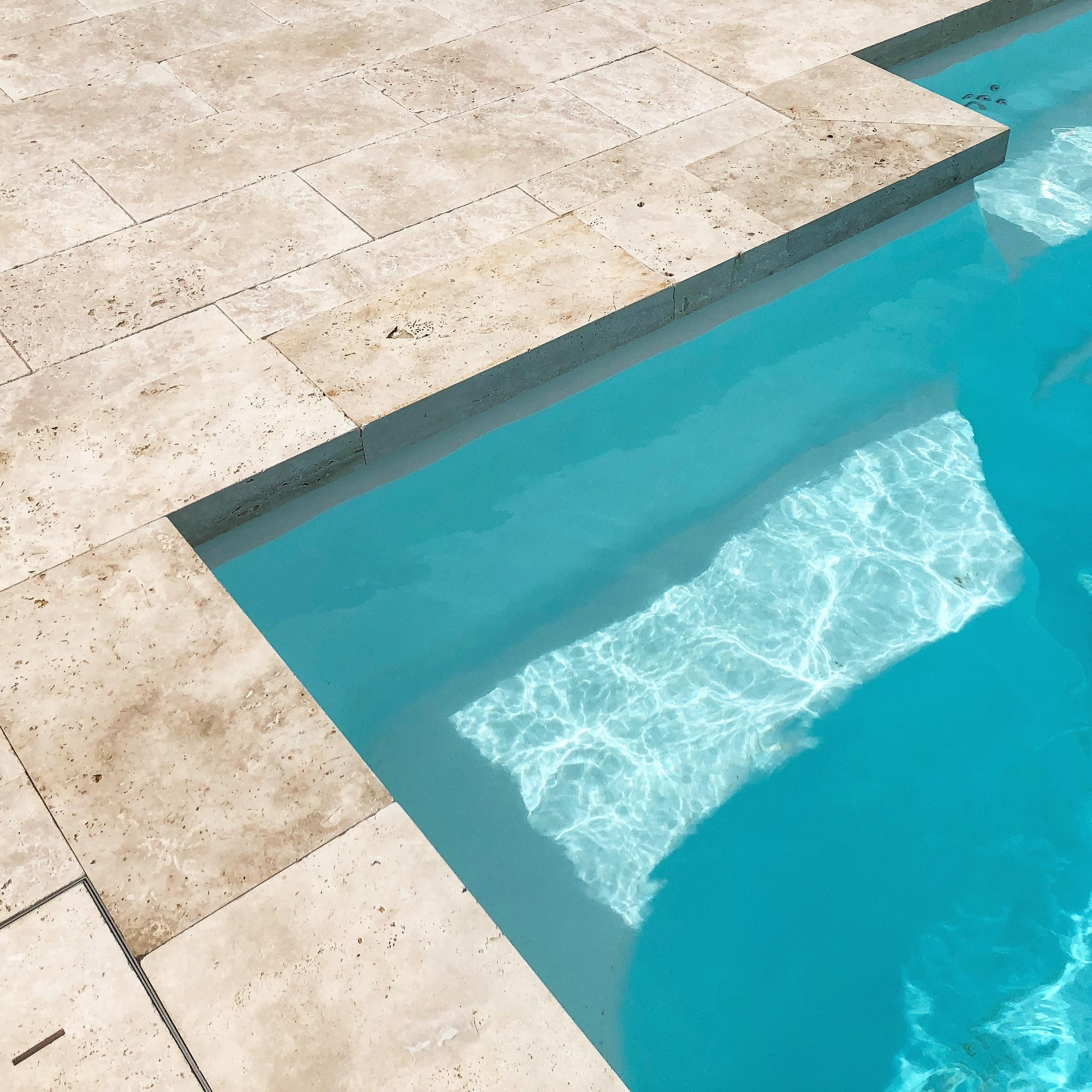 Roma Travertine Paving and Overhanging Lip Pool Capping