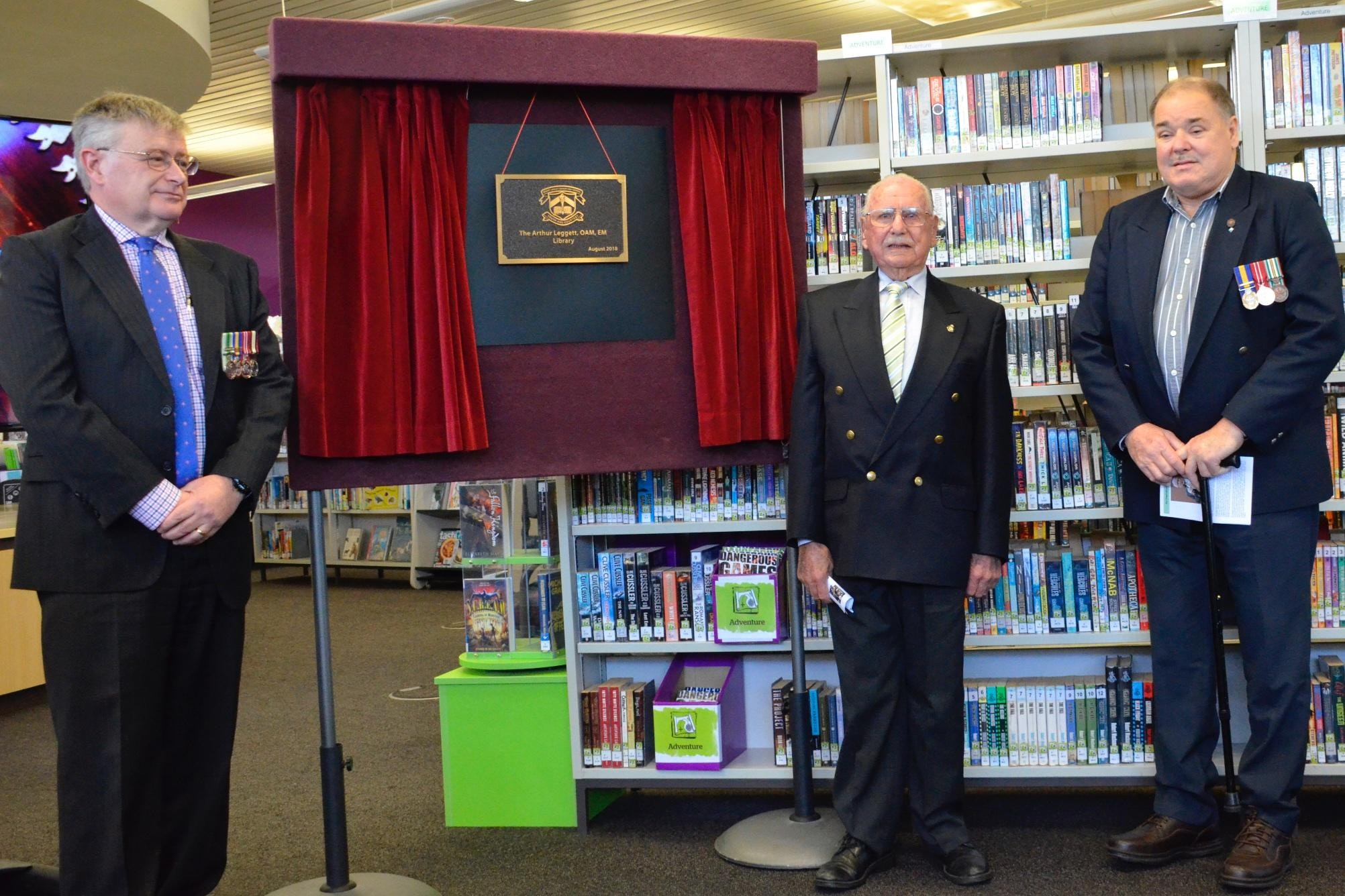 Mr Leggett (centre) unveiling the plaque with (left) Mr Milton Butcher substantive Principal Mount Lawley SHS and Mr Ray Galliott (right) Secretary/treasurer Ex POW Association WA