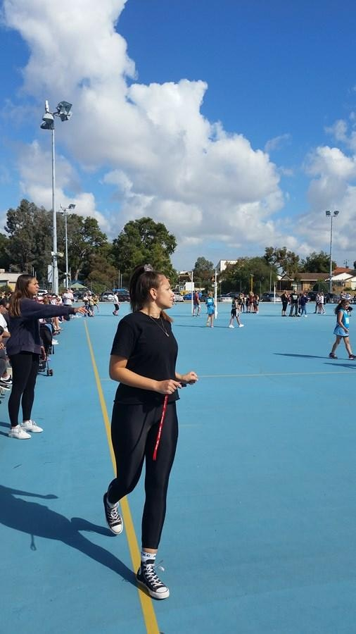 Sister Act - Brooklyn Nannup umpiring and in the background Georgia Nannup coaching a Junior Morley Districts netball team.