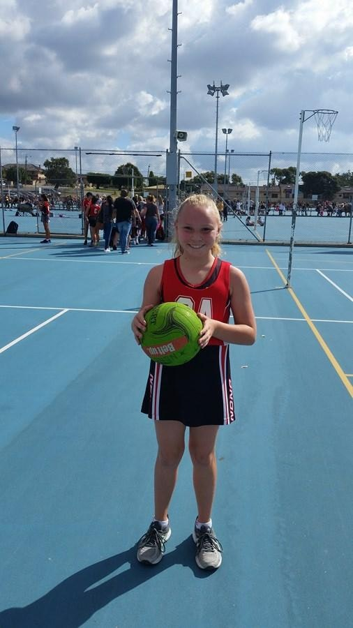 Year 7 Netball student Hannah Griffiths preparing to go on court.